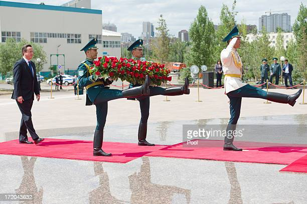 British Prime Minister David Cameron takes part in a wreathlaying ceremony at the Monument of the Motherland Defenders on July 1 2013 in Astana...