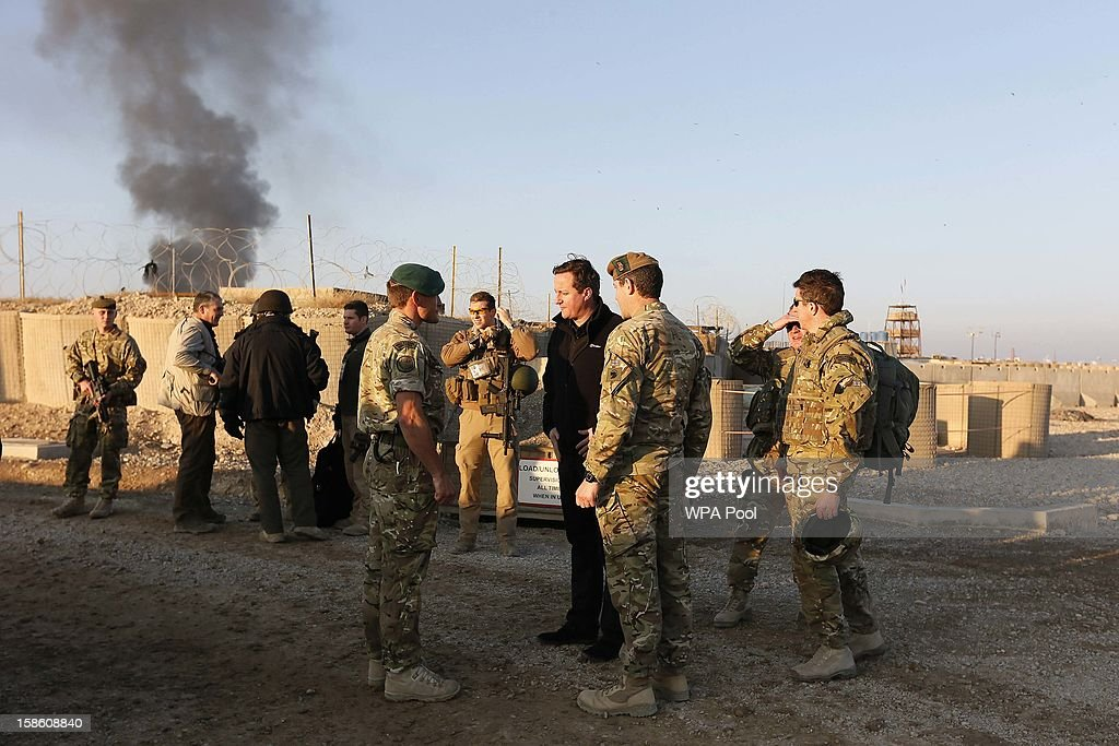 British Prime Minister David Cameron (4th R) talks to British soldiers during a visit to Forward Operating Base Price on December 20, 2012 in Helmand Province, Afghanistan. Prime Minister Cameron is making a Christmas visit to British troops in the region amid tight security.