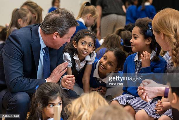 British Prime Minister David Cameron talks to pupils during a visit at Reach Academy Feltham on July 12 2016 in London England British Prime Minister...