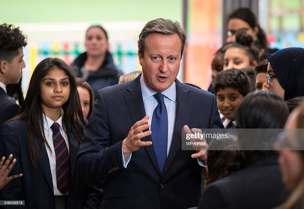 British Prime Minister David Cameron (L) talks to pupils during a visit at Reach Academy Feltham on July 12, 2016 in London, England. British Prime Minister David Cameron will step aside tomorrow (Wednesday) after his final Prime Minister's Questions allowing current Home Secretary Theresa May to move into 10 Downing Street. She was selected unopposed by Conservative MPs to be their new leader.