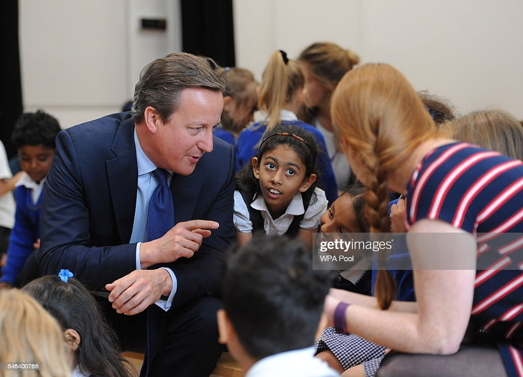 British Prime Minister David Cameron talks to pupils during a visit at Reach Academy Feltham on July 12, 2016 in London, England. British Prime Minister David Cameron will step aside tomorrow (Wednesday) after his final Prime Minister's Questions allowing current Home Secretary Theresa May to move into 10 Downing Street. She was selected unopposed by Conservative MPs to be their new leader.