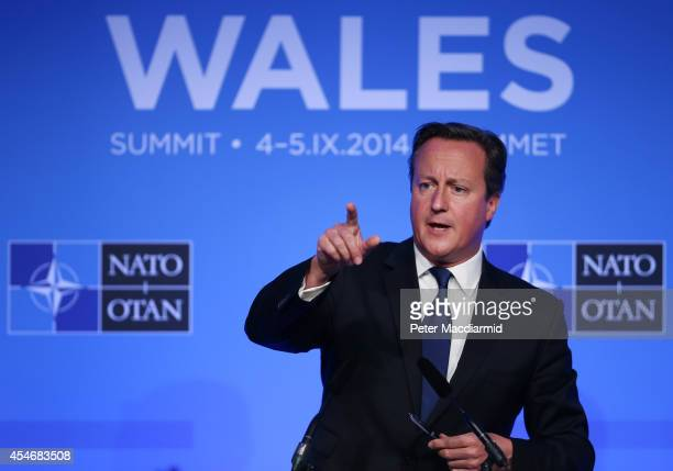 British Prime Minister David Cameron talks to reporters at the NATO Summit on September 5 2014 in Newport Wales Leaders and senior ministers from...