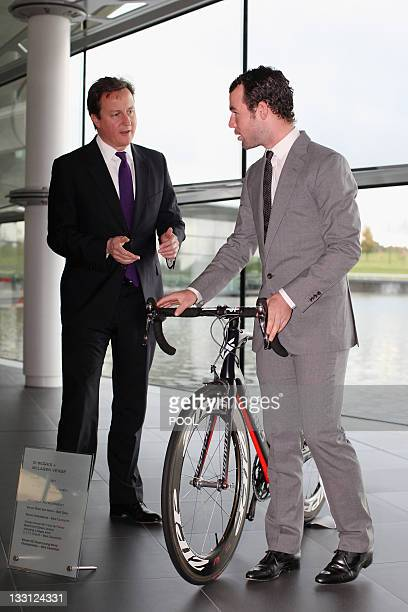 British Prime Minister David Cameron talks with British cyclist Mark Cavendish during a visit to the McLaren Technology Centre in Woking, south-east...