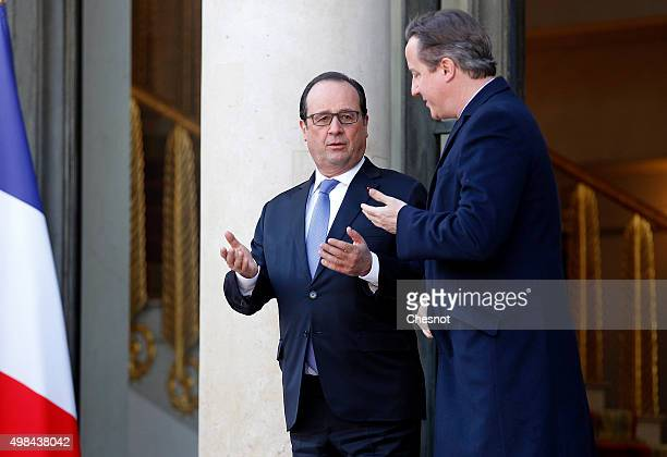 British Prime Minister David Cameron talks with French President Francois Hollande after their meeting at the Elysee Presidential Palace on November...