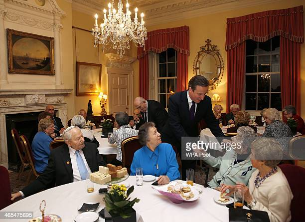 British Prime Minister David Cameron talks with guests during a reception for survivors of the Holocaust to commemorate International Holocaust...