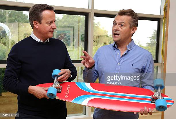British Prime Minister David Cameron talks with Managing Director of Shiner Ltd Charlie Allen at the sports equipment distributor's offices on June...