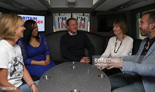 British Prime Minister David Cameron talks with Shiner Ltd Head of HR Marie Hodgson Founder of Isabella Queen bags Isabelle Ugochukwu Labour MP...