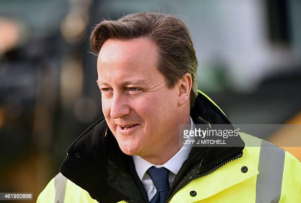 British Prime Minister David Cameron views new building work at Edinburgh Airport in Scotland on January 22, 2015. Britain's government published a...