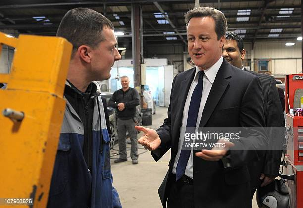 British Prime Minister David Cameron visits the Adamsons Vehicle Care Centre as he campaigns with local Conservative candidate Kashif Ali in Oldham...