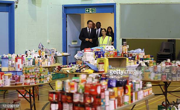 British Prime Minister David Cameron visits the Community Assistance Centre in Tottenham Green Leisure Centre with local MP David Lammy on August 16...