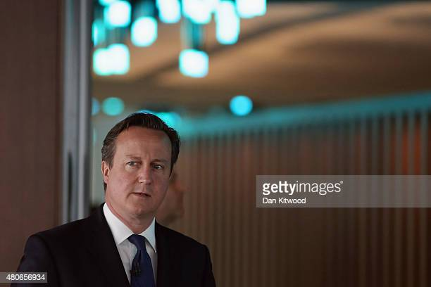 British Prime Minister David Cameron waits to be welcomed on stage to take questions during a QA session at The Times offices on July 14 2015 in...