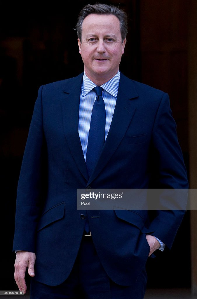 British Prime Minister David Cameron waits to greet German Chancellor Angela Merkel ahead of their meeting at Chequers, the Prime Minister's country residence on October 9, 2015 near Aylesbury, Buckinghamshire, United Kingdom. The meeting between the two leaders is expected to focus on Britain's EU renegotiation aims.