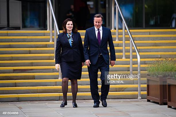 British Prime Minister David Cameron walks from the main hall with Caroline Ansell MP for Eastbourne and Willingdon on the third day of the annual...