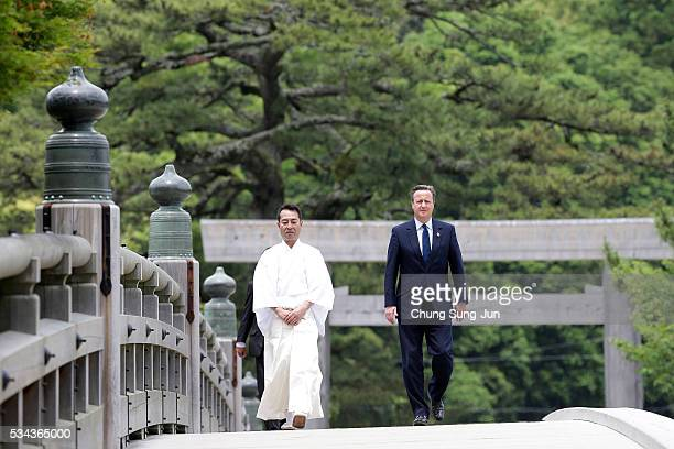 British Prime Minister David Cameron walks on the Ujibashi bridge as he visit at the IseJingu Shrine on May 26 2016 in Ise Japan In the twoday summit...