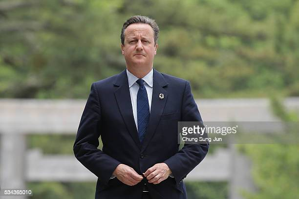 British Prime Minister David Cameron walks on the Ujibashi bridge as he visit at the IseJingu Shrine on May 26 2016 in Ise Japan In the twoday summit...