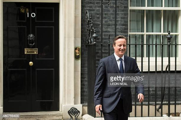 British Prime Minister David Cameron walks out of 10 Downing Street to greet his Ukrainian counterpart Arseniy Yatsenyuk in central London on 15 July...
