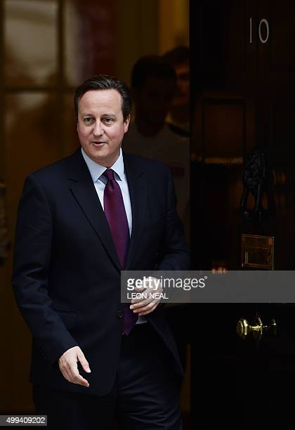 British Prime Minister David Cameron walks out of 10 Downing street in London on December 1 2015 Britain looks poised to join air strikes on Islamic...
