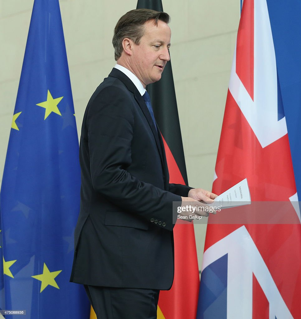 British Prime Minister David Cameron walks past the flags of the European Union (L) and the United Kingdom as he arrives to speak to the media with German Chancellor Angela Merkel (not pictured) following talks at the Chancellery on May 29, 2015 in Berlin, Germany. Cameron is in Berlin as part of his tour of European Union member states capitals in order to persuade leaders of the necessity of E.U. reforms.