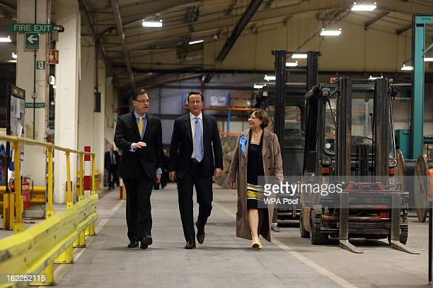British Prime Minister David Cameron walks through the factory floor with local Conservative candidate Maria Hutchings and Paul Atkinson CEO of...