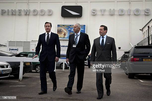 British Prime Minister David Cameron walks with CEO Pinewood Group Ivan Dunleavy and Minister for Culture Communications and Creative Industries Ed...