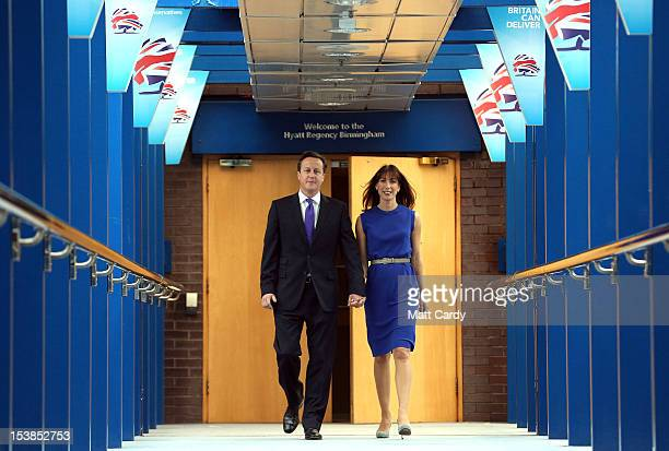 British Prime Minister David Cameron walks with his wife Samantha to deliver his speech to delegates on the last day of the Conservative party...