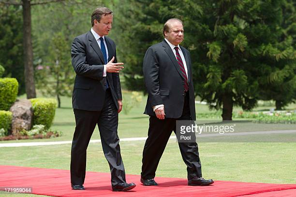 British Prime Minister David Cameron walks with Pakistani Prime Minister Nawaz Sharif at the Prime Minister's house on June 30 2013 in Islamabad...