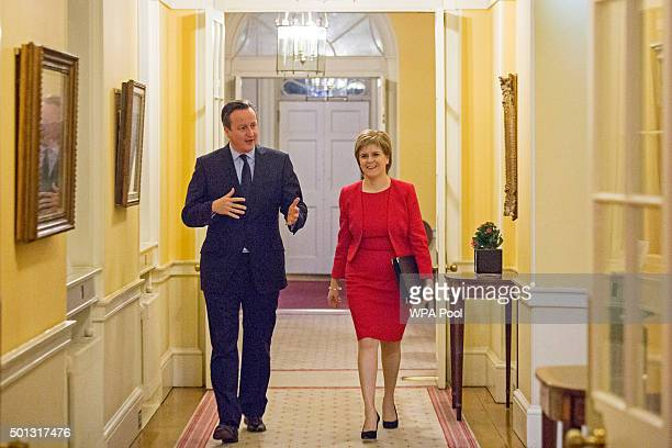 British Prime Minister David Cameron walks with Scottish First Minister Nicola Sturgeon as she arrives for talks at 10 Downing Street on December 14...