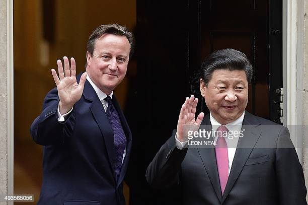 British Prime Minister David Cameron waves as he greets Chinese President Xi Jinping on the steps of 10 Downing Street in central London on October...