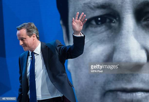 British Prime Minister David Cameron waves during the filming of 'Cameron Miliband The Battle For Number 10' on March 26 2015 in London England The...