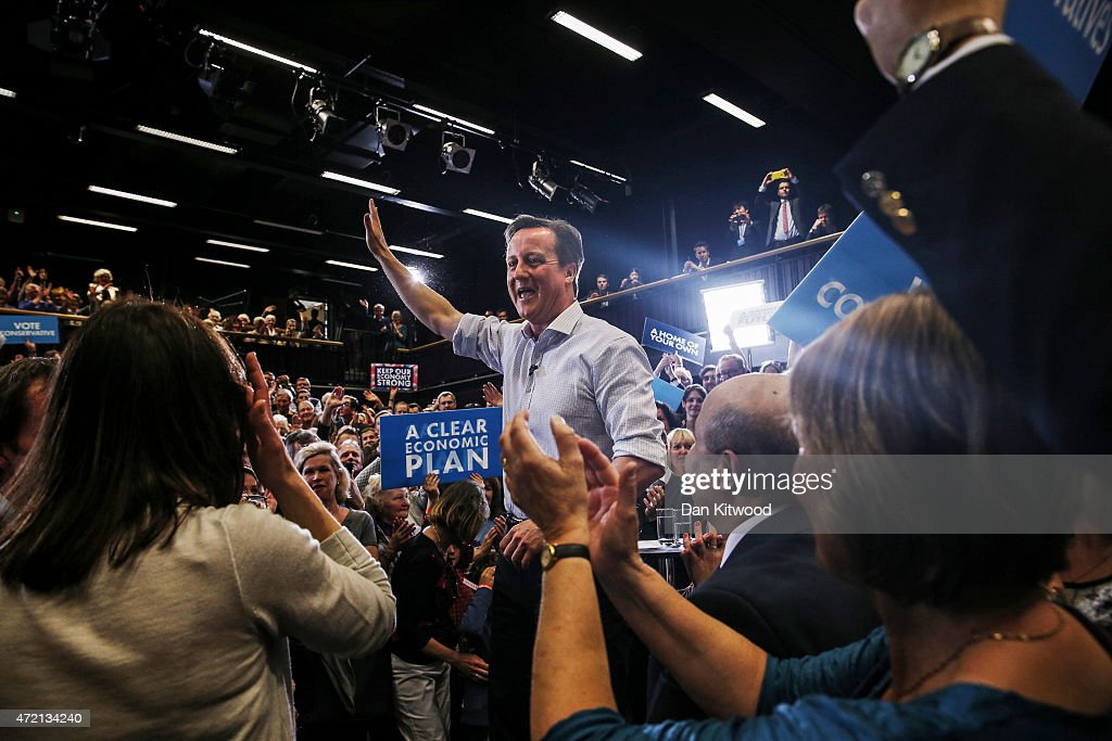 British Prime Minister David Cameron waves to supporters after a rally at Hayesfield Girls' School on May 4, 2015 in Bath, United Kingdom. Campaigning is intensifying as the election enters it's last few days before voting begins on May 7, 2015.