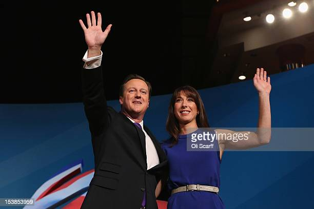 British Prime Minister David Cameron waves with his wife Samantha Cameron after his speech to delegates on the last day of the Conservative party...