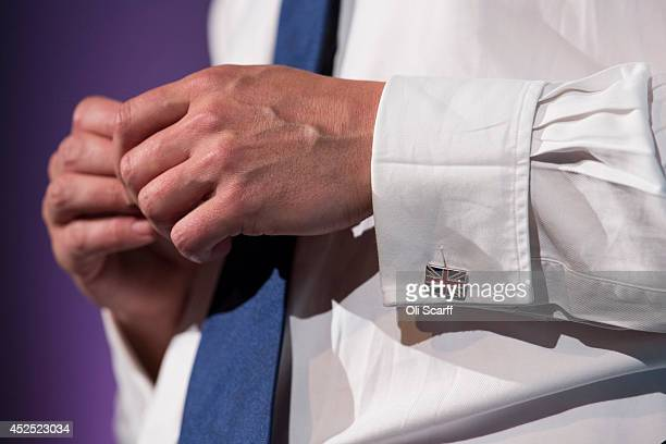 British Prime Minister David Cameron wears Union Flag cufflinks as he speaks at the 'Girl Summit 2014' in Walworth Academy on July 22, 2014 in...