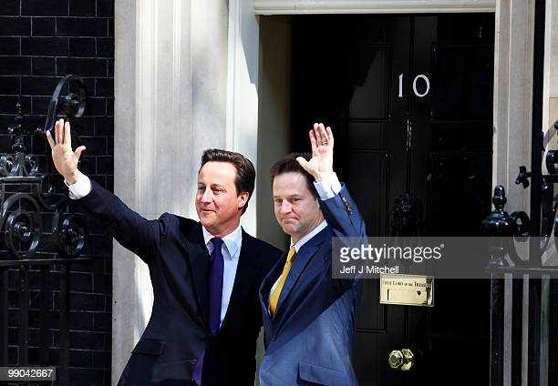 British Prime Minister David Cameron welcomes Deputy Prime Minister Nick Clegg to Downing Street for their first day of coalition government on May...
