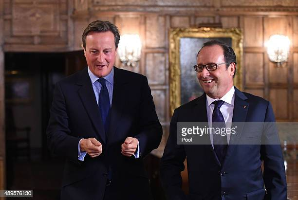 British Prime Minister David Cameron welcomes French President Francois Hollande to Chequers for a bilateral meeting and a working dinner on...