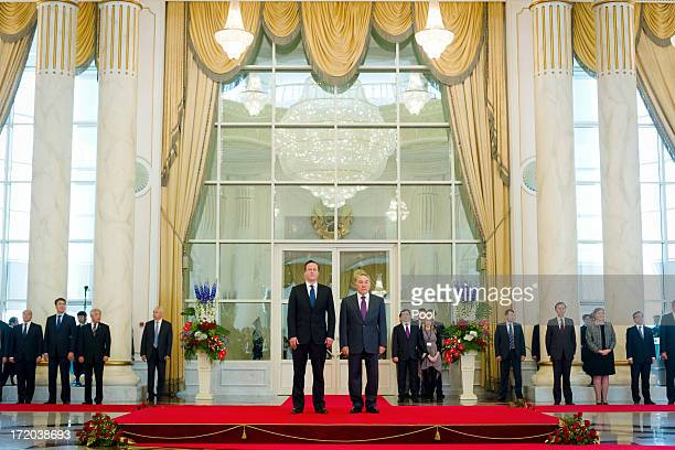 British Prime Minister David Cameron with Kazakhstan President Nursultan Nazarbayev as they listen to the nationl anthem at the Presidential Palace...