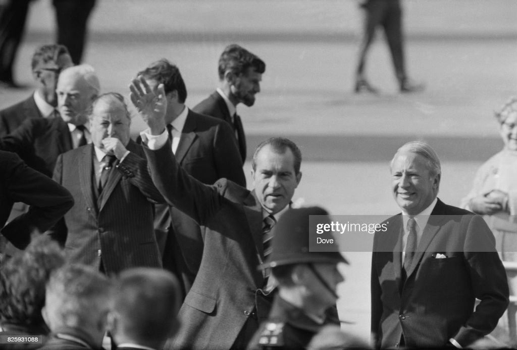 British Prime Minister Edward Heath (1916 - 2005) and U.S. President Richard Nixon (1913 - 1994) greet the crowd upon Nixon's arrival at L.A.P. (now Heathrow), London, 3rd October 1970.