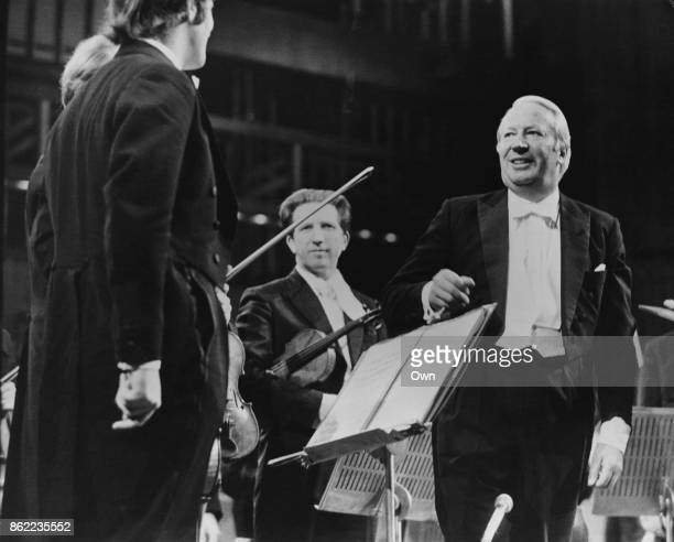 British Prime Minister Edward Heath conducts the Royal Symphony Orchestra in a performance of Elgar's 'Cockaigne Overture' at the Royal Festival Hall...