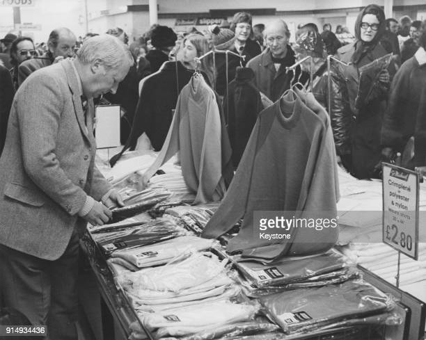 British Prime Minister Edward Heath goes Christmas shopping for crimplene or nylon and polyester leisure shirts in a Marks Spencer store in Aylesbury...