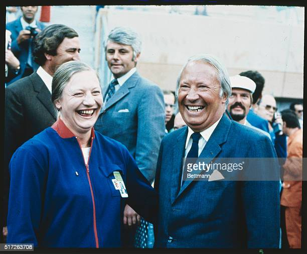"""British Prime Minister Edward Heath is all smiles as he congratulated Mary Peters on her gold medal. The British """"girl"""" was the winner of the Olympic..."""