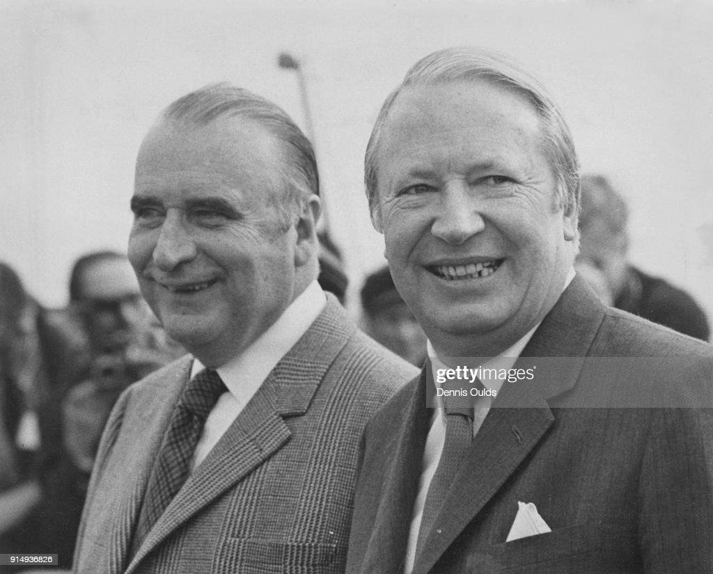 British Prime Minister Edward Heath (1916 - 2005) meets French President Georges Pompidou (left) upon the latter's arrival at Northolt, UK, by air, 18th March 1972. Pompidou will be holding talks with Heath at Chequers over the weekend.