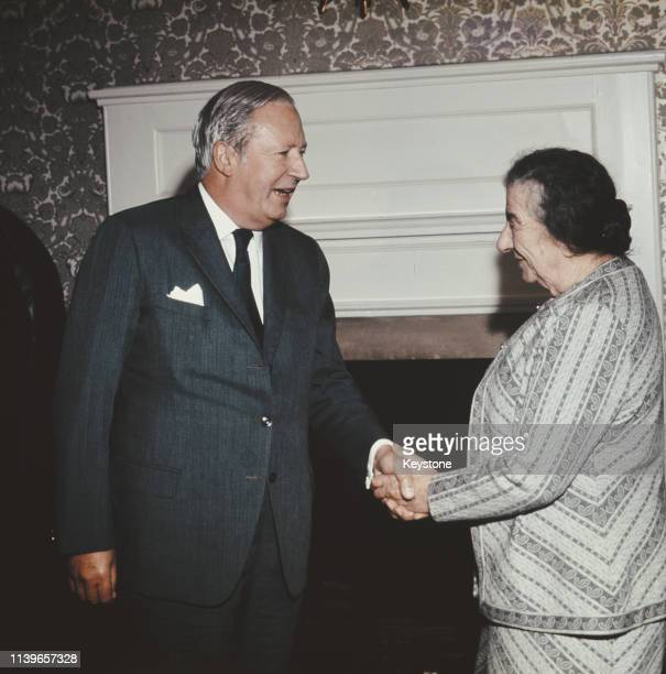 British Prime Minister Edward Heath shakes hands with Golda Meir the Prime Minister of Israel during a press conference at the Churchill Hotel in...