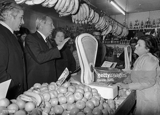 British Prime Minister Edward Heath talks to shop assistant Sheila Kane in a greengrocer's shop on Mill Hill Broadway London during an electioneering...