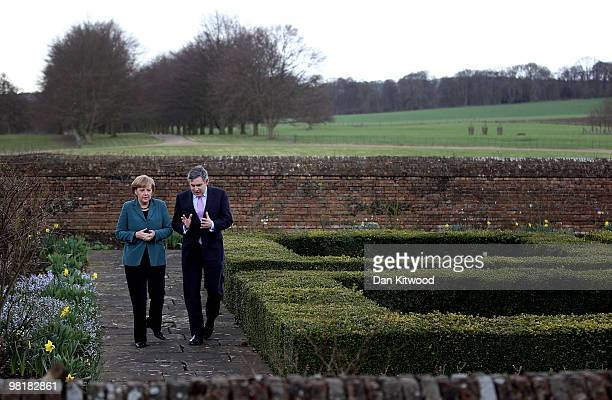 British Prime Minister Gordon Brown and German Chancellor Angela Merkel walk around the garden at Chequers the Prime Minister's official country...