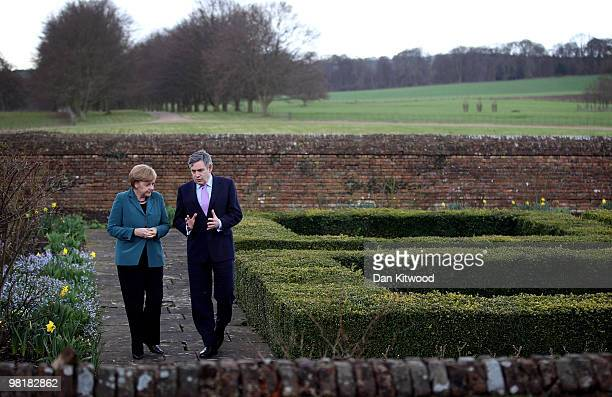 British Prime Minister Gordon Brown and German Chancellor Angela Merkel walk around the garden at Chequers, the Prime Minister's official country...