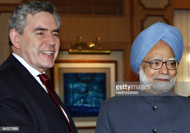British Prime Minister Gordon Brown and his Indian counterpart Manmohan Singh look on during a morning meeting at Singh's residence in New Delhi on...