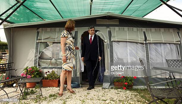 L'AQUILA ITALY JULY 10 British Prime Minister Gordon Brown and his wife Sarah Brown emerge from a tent during a visit to the earthquakedamaged...