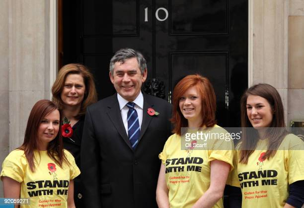British Prime Minister Gordon Brown and his wife Sarah Brown meet volunteer collectors for the Poppy Appeal outside Number 10 Downing Street on...