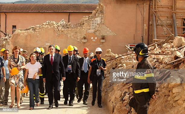 L'AQUILA ITALY JULY 10 British Prime Minister Gordon Brown and his wife Sarah Brown visit the earthquakedamaged Italian town of Onna with expat...