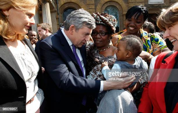 British Prime Minister Gordon Brown and his wife Sarah Brown with the congregation outside Wesley's Chapel during his campaign tour on April 18 2010...