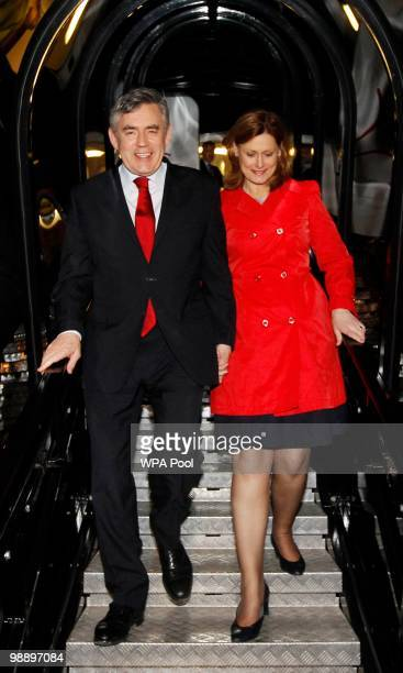 British Prime Minister Gordon Brown and his wife Sarah disembark from an airplane at Stansted airport as he returns to London party headquarters on...